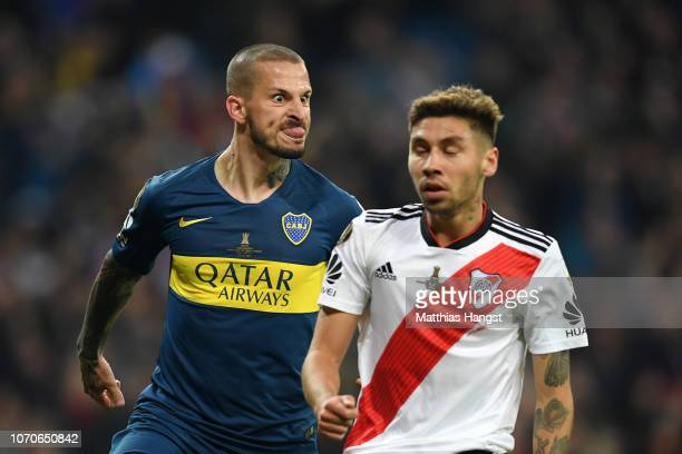 Dario Benedetto of Boca Juniors pulls a face at Gonzalo Montiel of River Plate as he celebrates after scoring his team's first goal during the second...