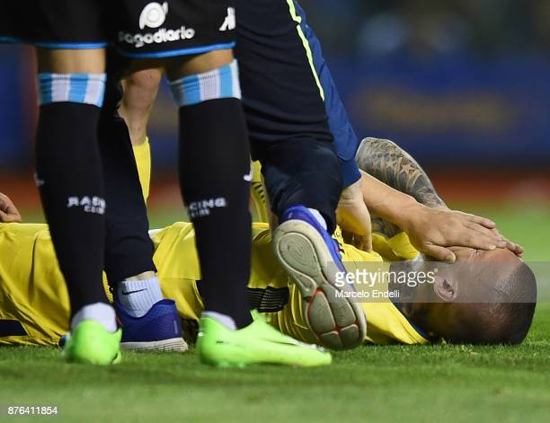 Dario Benedetto of Boca Juniors reacts after being injured during a match between Boca Juniors and Racing Club as part of the Superliga 2017/18 at...