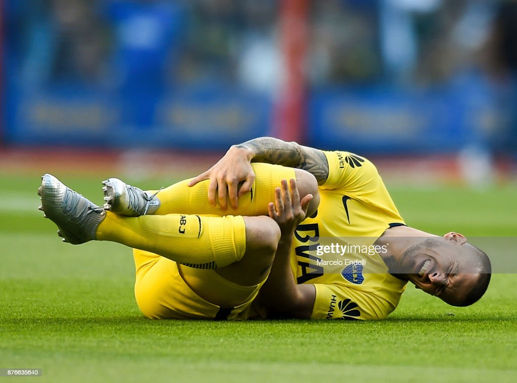Dario Benedetto of Boca Juniors reacts after being injured during a match between Boca Juniors and Racing Club as part of the Superliga 2017/18 at Alberto J. Armando Stadium on November 19, 2017 in Buenos Aires, Argentina.