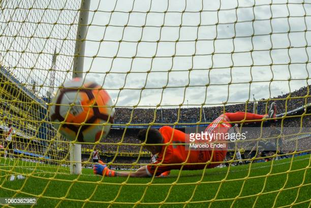 Dario Benedetto of Boca Juniors scores the second goal of his team during the first leg match between Boca Juniors and River Plate as part of the...