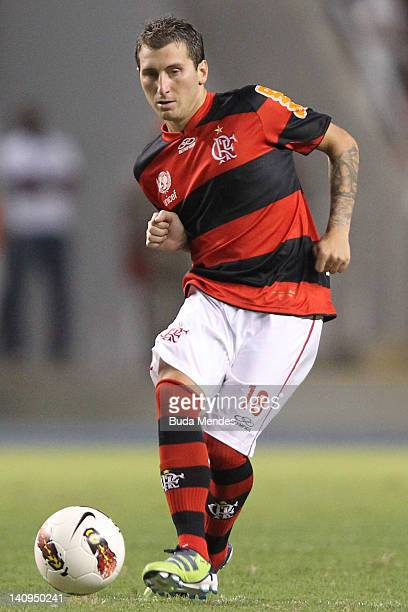 Dario Botinelli of Flamengo struggles for the ball during a match between Flamengo and Emelec as part of Santander Libertadores Cup 2012 at Engenhao...