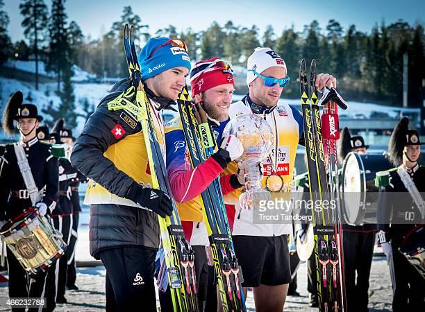 Dario Cologna of Swiss Winner Martin Johnsrud Sundby of Norway Petter Northug of Norway 3nd celebrate winning OverAll FIS World Cup 50 km F Mass...