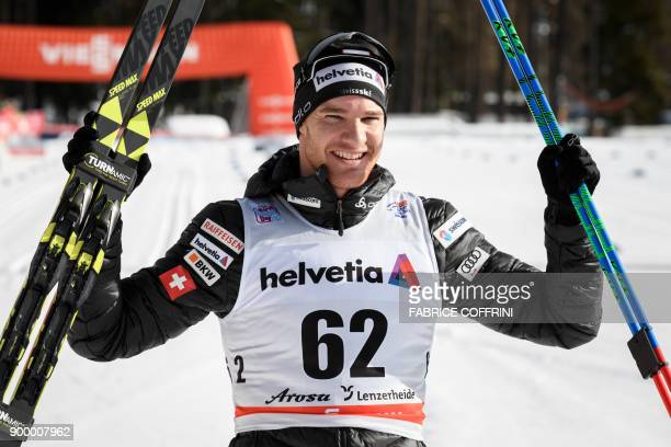 Dario Cologna of Switzerland celebrates his victory in the Men's 15 km classic during the cross country FIS World cup Tour de Ski event on December...