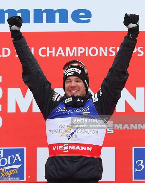 Dario Cologna of Switzerland celebrates victory in the Men's Skiathlon at the FIS Nordic World Ski Championships on February 23, 2013 in Val di...