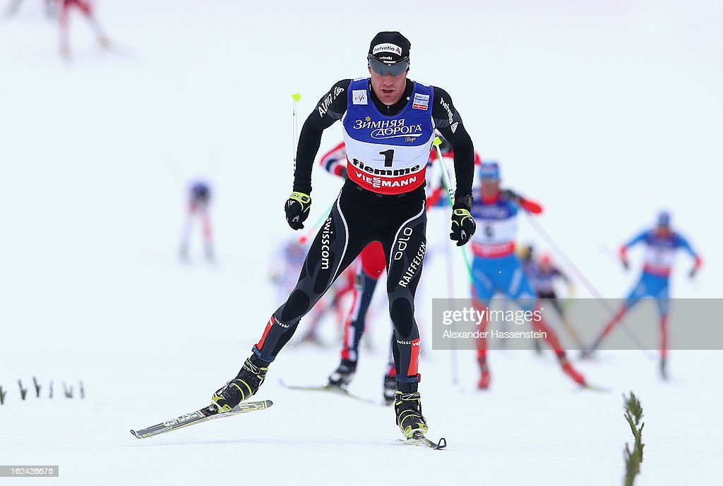 Dario Cologna of Switzerland leads the pack on his way to victory in the Men's Skiathlon at the FIS Nordic World Ski Championships on February 23, 2013 in Val di Fiemme, Italy.