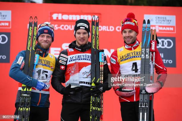 Dario Cologna of Switzerland takes 1st place Martin Johnsrud Sundby of Norway takes 2nd place Alex Harvey of Canada takes 3rd place during the FIS...