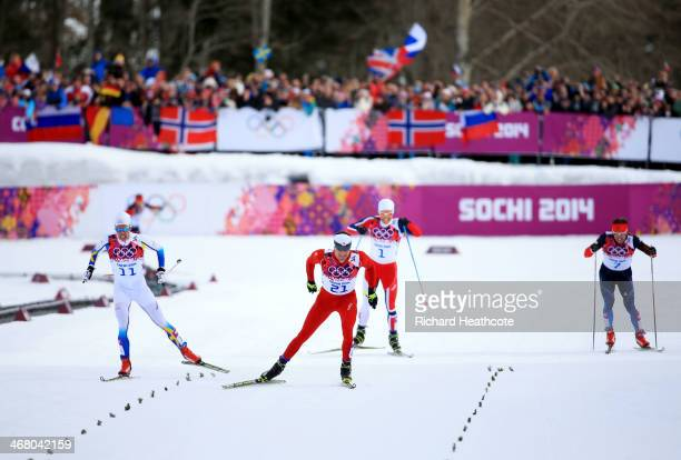 Dario Cologna of Switzerland wins the Men's Skiathlon 15 km Classic + 15 km Free during day two of the Sochi 2014 Winter Olympics at Laura...