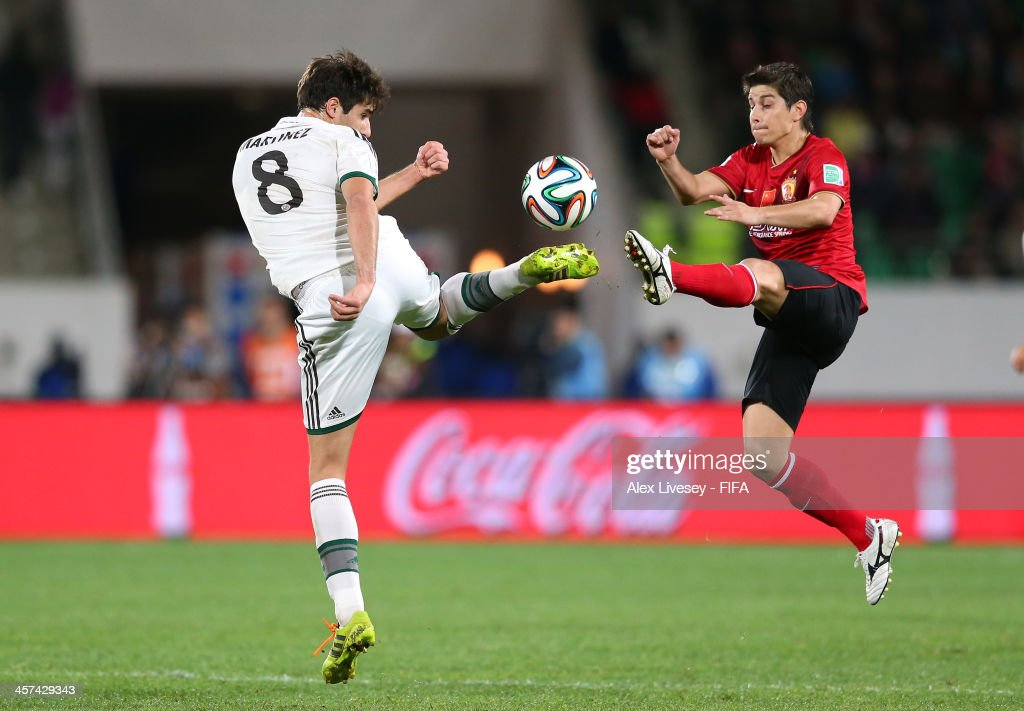 Dario Conca of Guangzhou Evergrande FC and Javier Martinez of Bayern Muenchen challenge for the ball during the FIFA Club World Cup Semi Final match between Guangzhou Evergrande FC and Bayern Muenchen at the Agadir Stadium on December 17, 2013 in Agadir, Morocco.