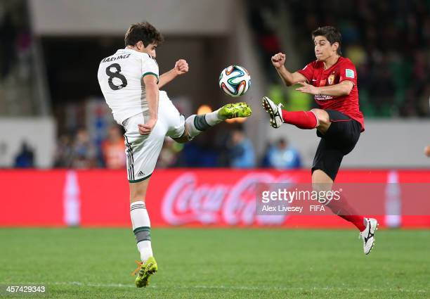 Dario Conca of Guangzhou Evergrande FC and Javier Martinez of Bayern Muenchen challenge for the ball during the FIFA Club World Cup Semi Final match...