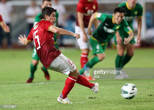 Dario Conca of Guangzhou Evergrande scores his team's second goal with a penalty-kick during the Chinese Super League match between Guangzhou...