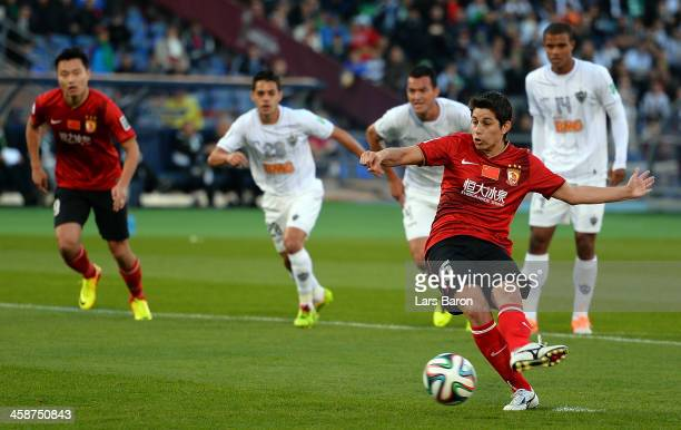 Dario Conca of Guangzhou scores his teams second goal during the FIFA Club World Cup 3rd Place Match between Guangzhou Evergrande FC and Atletico...