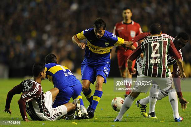 Dario Cvitanich from Boca Juniors drives the ball during a match as part of the Santander Libertadores Cup at Alberto J Armando Stadium on Mayo 17...