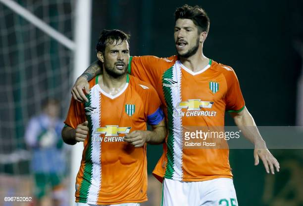 Dario Cvitanich of Banfield celebrates with teammate Carlos Matheu after scoring the third goal of his team during a match between Banfield and...