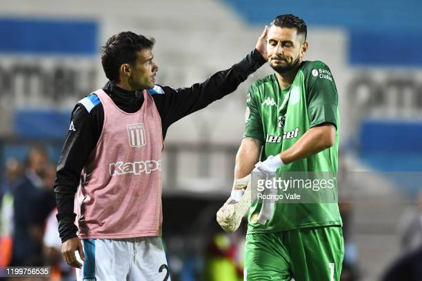 Dario Cvitanich of Racing Club embraces teammate Gabriel Arias after being sent off during a match between Racing Club and Independiente as part of...