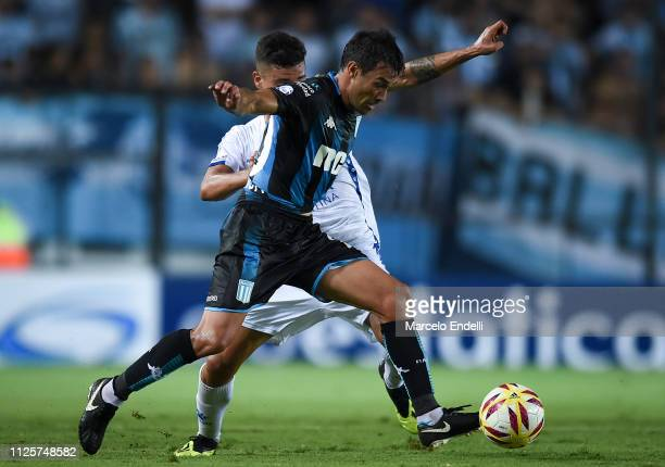 Dario Cvitanich of Racing Club fights for the ball with Agustin Aleo of Godoy Cruz during a match between Racing Club and Godoy Cruz at Juan Domingo...