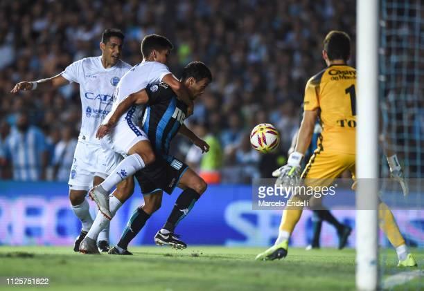 Dario Cvitanich of Racing Club fights for the ball with Hernan Bernardello of Godoy Cruz during a match between Racing Club and Godoy Cruz at Juan...