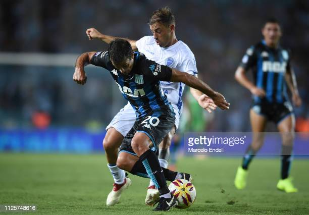 Dario Cvitanich of Racing Club fights for the ball with Valentin Burgos of Godoy Cruz during a match between Racing Club and Godoy Cruz at Juan...