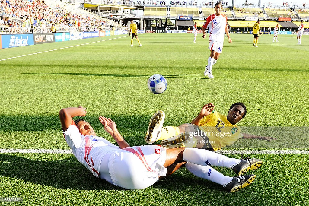 Dario Delgado #2 of Costa Rica and Demar Phillips #12 of Jamaica collide while chasing a loose ball at Crew Stadium on July 7, 2009 in Columbus, Ohio.