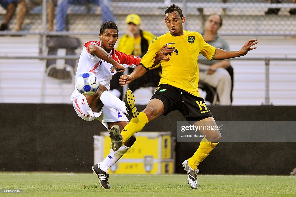 Dario Delgado #2 of Costa Rica and Tyrone Marshall #14 of Jamaica battle for the ball at Crew Stadium on July 7, 2009 in Columbus, Ohio.