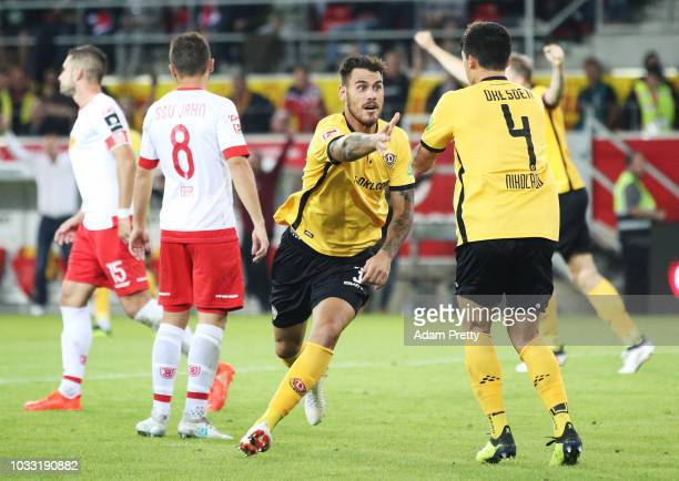 Dario Dumic of Dynamo Dresden celebrates scoring the second goal during the Second Bundesliga match between SSV Jahn Regensburg and SG Dynamo Dresden...