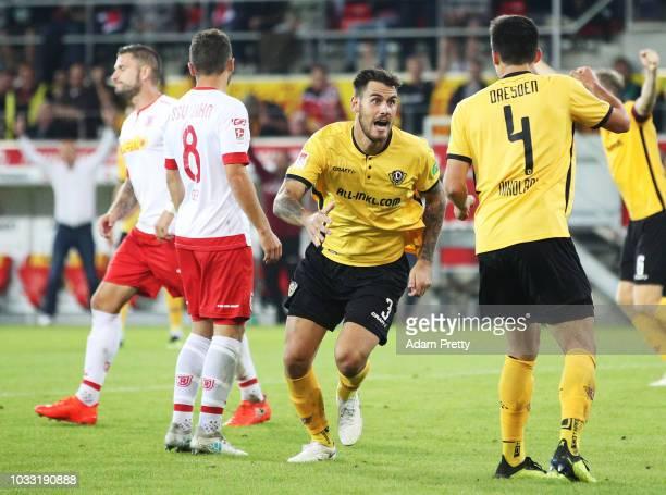 Dario Dumic of Dynamo Dresden celebrates scoring the second goal during the Second Bundesliga match between SSV Jahn Regensburg and SG Dynamo Dresden...
