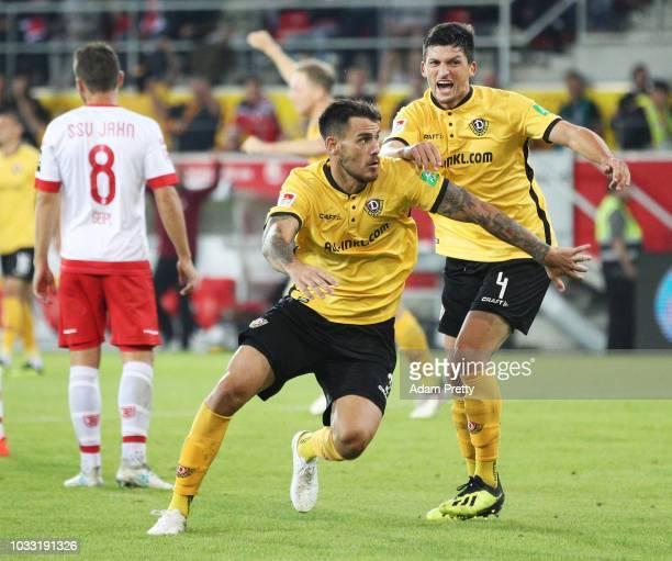 Dario Dumic of Dynamo Dresden celebrates scoring the second goal with Jannis Nikolaou of Dynamo Dresden during the Second Bundesliga match between...