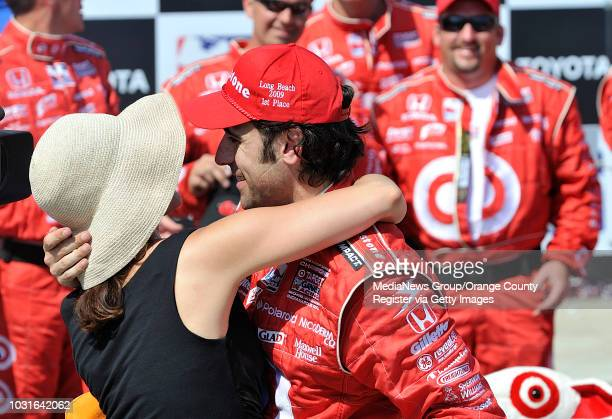 BEACH CA Dario Franchetti hugs his wife Ashley Judd after winning the 35th Annual Toyota Grand Prix of Long Beach on April 19 2009 Photo by