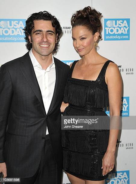 Dario Franchitti and Ashley Judd arrive at the USA Today Hollywood Hero Awards at Montage Beverly Hills on November 10 2009 in Beverly Hills...