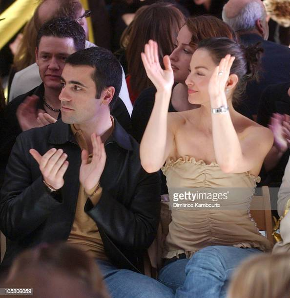 Dario Franchitti and Ashley Judd during Olympus Fashion Week Fall 2004 Tuleh Front Row at The Promenade at Bryant Park in New York City New York...