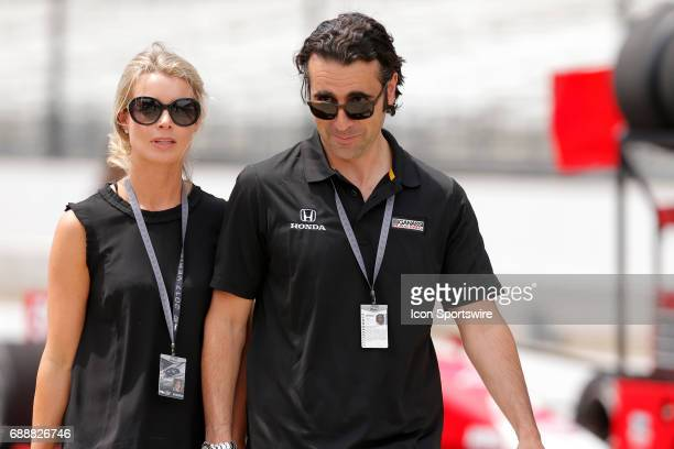 Dario Franchitti and his wife Eleanor walk down pit lane during Carb Day on May 26 at the Indianapolis Motor Speedway in Indianapolis Indiana