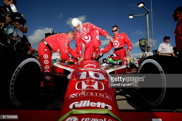 Dario Franchitti climbs aboard the Target Chip Ganassi Racing Dallara Honda before the start of the IRL IndyCar Series Firestone Indy 300 on October...