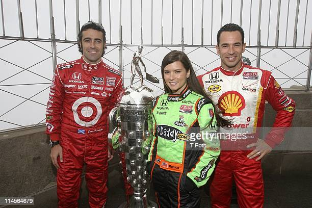 Dario Franchitti Danica Patrick and Helio Castroneves visits The Empire State Building on May 23 2011 in New York City