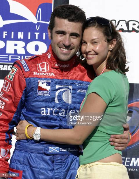 Dario Franchitti driver of the Andretti Green Racing ArcaEx Honda Dallara celebrates with his wife actress Ashley Judd after winning the Indy Racing...