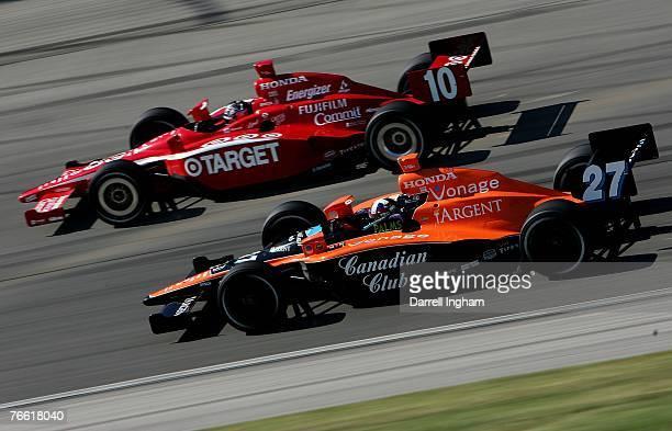 Dario Franchitti driver of the Andretti Green Racing Dallara Honda races alongside Dan Wheldon driving the Target Chip Ganassi Racing Dallara Honda...