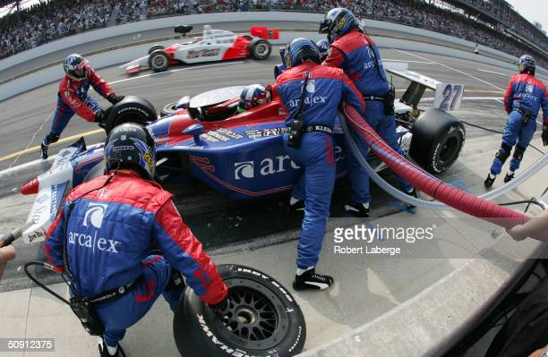Dario Franchitti driver of the Arca/Ex Andretti Green Racing Honda Dallara makes a pit stop during the 88th running of the Indianapolis 500 part of...