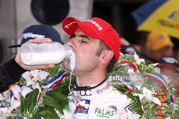 Dario Franchitti driver of the Canadian Club Andretti Green Racing Dallara Honda celebrates with the traditional bottle of winner's milk in victory...