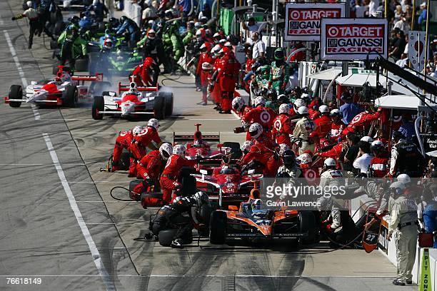 Dario Franchitti driver of the Canadian Club Andretti Green Racing Dallara Honda Scott Dixon driver of the Target Chip Ganassi Racing Dallara Honda...