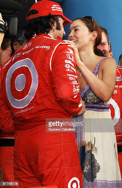 Dario Franchitti driver of the Target celebrates winning the IndyCar Series Championship with a kiss from his wife the actress Ashley Judd at the IRL...