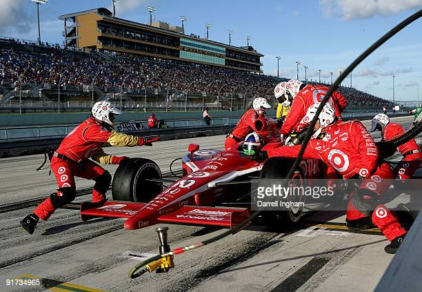 Dario Franchitti driver of the Target Chip Ganassi Racing Dallara Honda makes a pitstop during the the IRL IndyCar Series Firestone Indy 300 on...