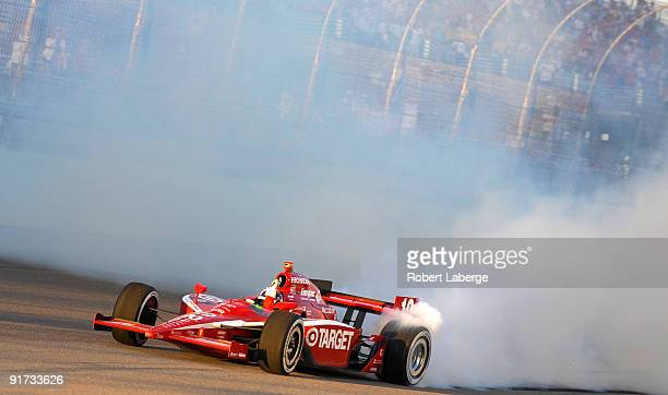 Dario Franchitti driver of the Target Chip Ganassi Racing Dallara Honda celebrates after winning the IRL IndyCar Series Firestone Indy 300 and the...
