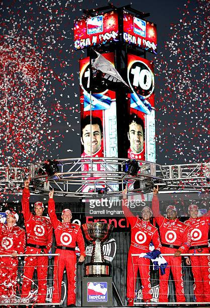 Dario Franchitti driver of the Target Chip Ganassi Racing Dallara Honda celebrates winning the IndyCar Series Championship at the IRL IndyCar Series...