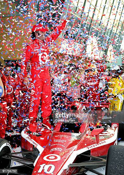 Dario Franchitti driver of the Target Chip Ganassi Racing Dallara Honda celebrates winning the the IRL IndyCar Series Firestone Indy 300 on October...