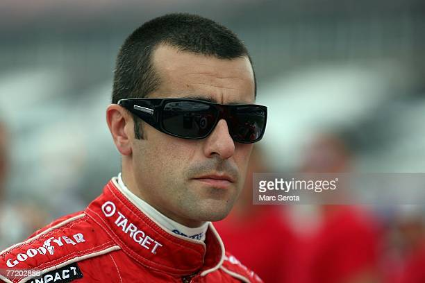 Dario Franchitti driver of the Target Dodge walks in the garage following practice for the ARCA RE/MAX Series 250 at Talladega Superspeedway on...