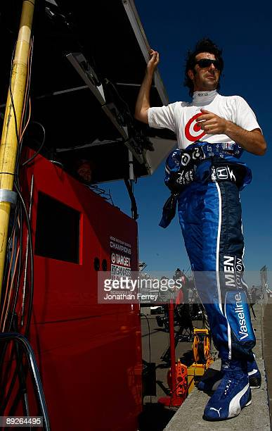 Dario Franchitti driver of the Vaseline Men Lotion Target Chip Ganassi Racing Dallara Honda stands on his pit box during warm up for the IRL IndyCar...