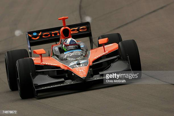 Dario Franchitti drives the Canadian Club Andretti Green racing Dallara Honda around turn one during the IRL Indycar Series Iowa Corn Indy 250 on...