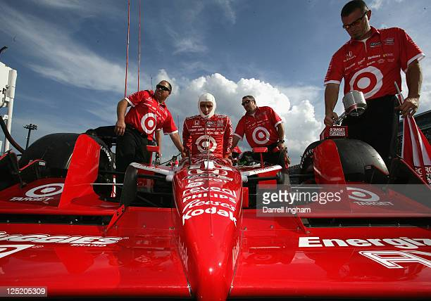 Dario Franchitti of Great Britain climbs aboard the Target Chip Ganassi Racing Dallara Honda during practice for the IZOD IndyCar Series Indy Japan...