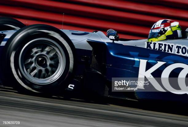 Dario Franchitti of Great Britain drives of the Team KOOL Green Reynard 02i Honda HRK during practice for the Championship Auto Racing Teams 2002...