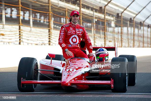 Dario Franchitti of Scotland driver of the Target Chip Ganassi Racing Dallara Honda poses on the front stretch after qualifying in third position for...