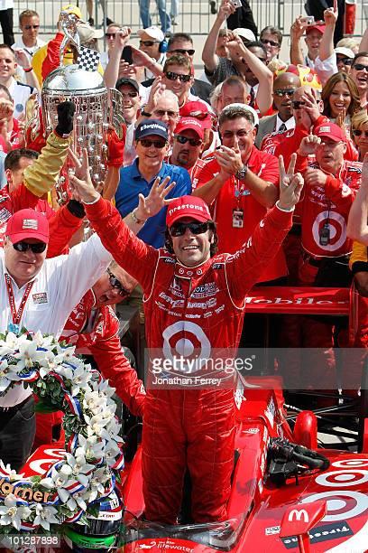 Dario Franchitti of Scotland driver of the Target Chip Ganassi Racing Dallara Honda celebrates in victory lane after winning the IZOD IndyCar Series...