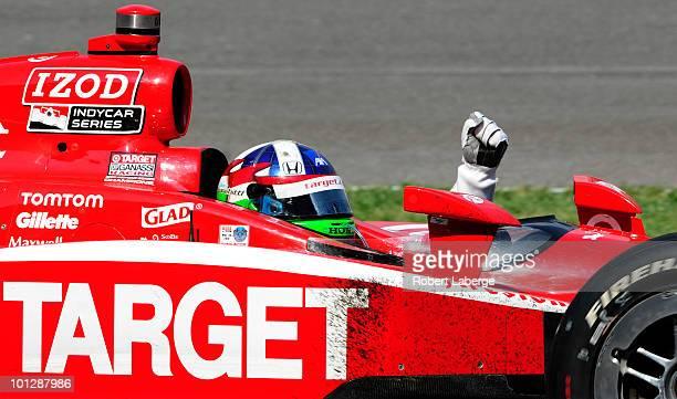 Dario Franchitti of Scotland driver of the Target Chip Ganassi Racing Dallara Honda celebrates after winning the IZOD IndyCar Series 94th running of...